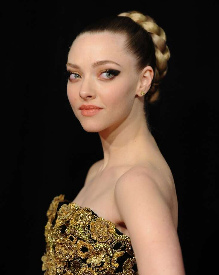 Actor Amanda Seyfried attends the premiere for Les Miserables at the Ziegfeld Theatre on Monday Dec. 10, 2012 in New York. (Photo by Evan Agostini/Invision/AP) Photo: Evan Agostini, Associated Press / Invision