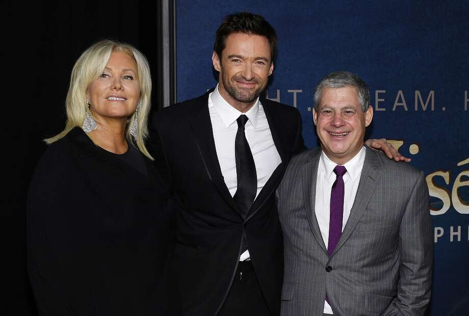 (L-R) Deborra-Lee Furness, Hugh Jackman, and Cameron Mackintosh attend the Les Miserables New York Premiere at Ziegfeld Theater on December 10, 2012 in New York City.  (Photo by Larry Busacca/Getty Images) Photo: Larry Busacca, Getty Images / 2012 Getty Images