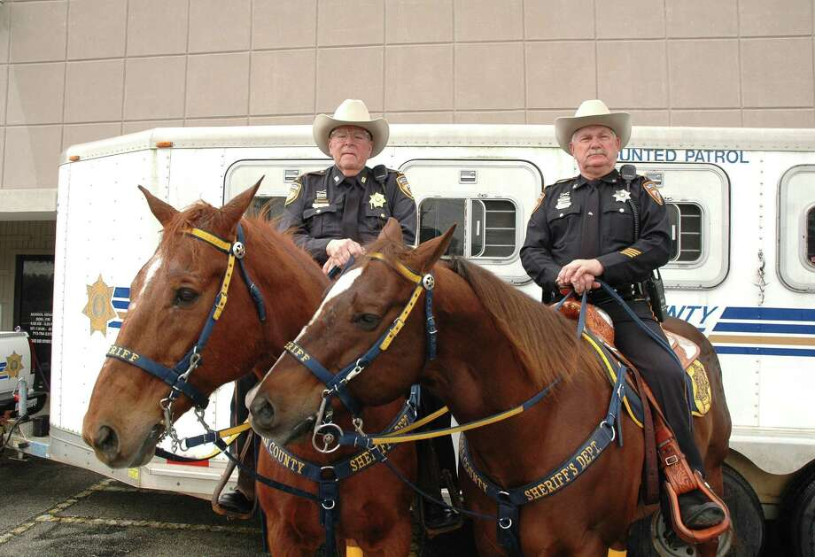 "Harris County Sheriff's Office Mounted Patrol Deputy Captain Gary Look and his horse ""Majic,"" left, and Deputy D. W. Finley and his horse ""Shadow"" are part of the patrol, which was created in 1949 by Sheriff Buster Kerns. Photo: George Wong / Freelance"