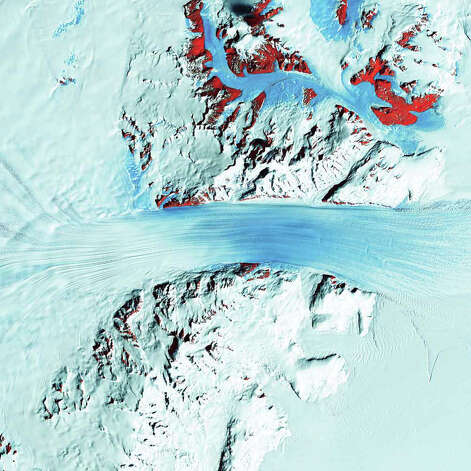 Just as rivers drain the continents, rivers also drain Antarctica—only in this frozen landscape, the rivers are ice. In some places, steep mountains channel the flowing ice sheets and compress them into fast-moving rivers of ice. The Byrd Glacier is one such place. Byrd Glacier flows through a deep valley in the Transantarctic Mountains, covering a distance of 180 kilometers and descending more than 1,300 meters as it flows from the polar plateau (left) to the Ross Ice Shelf (right). In this Landsat 7 image from 2000, long, sweeping flow lines are crossed in places by much shorter lines, which are deep cracks in the ice called crevasses. The conspicuous red patches indicate areas of exposed rock. Byrd Glacier is located near the principal U.S. Antarctic Research Base at McMurdo Station, and it is named after the American Antarctic explorer Richard E. Byrd. Photo: NASA
