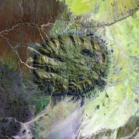 Over 120 million years ago, a single mass of granite punched through Earth's crust and intruded into the heart of the Namib Desert in what is now northern Namibia. Today, Brandberg Massif towers over the arid desert