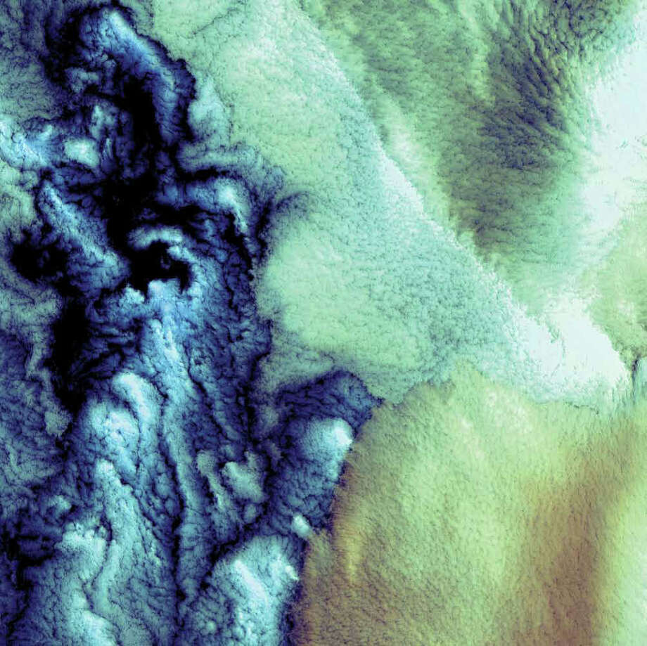 Clouds hover over the waters off the western Aleutian Islands, where fog, heavy rains, and high winds are common. While the clouds in this 2000 Landsat 7 image are structured differently, all the clouds shown are low, marine stratocumulus clouds, which often produce drizzle. The color variations are probably due to differences in the temperature and in the size of the water droplets that make up the clouds. The Aleutian Islands are part of the Pacific Ring of Fire. The archipelago curves out 1,800 kilometers from southwestern Alaska towards Russia's Kamchatka Peninsula. Photo: NASA