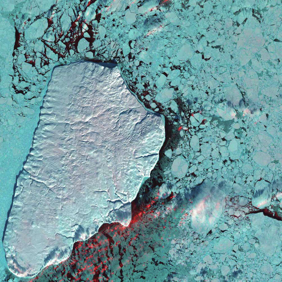 Akpatok Island rises sharply out of the frigid water of Ungava Bay in northern Quebec, Canada. Composed primarily of limestone, the island is a flat, treeless plateau 23 kilometers wide, 45 kilometers long, and about 150 to 250 meters high. This 2001 Landsat 7 image shows Akpatok Island completely covered in snow and ice. Small, dark patches of open water appear between pieces of pale blue-green sea ice, and a few scattered clouds are shown in red. The surrounding sea and ice are home to polar bears, walruses, and whales. A traditional hunting ground for native Inuit people, Akpatok is almost inaccessible except by air. The island is an important sanctuary for seabirds that make their nests in the steep cliffs that circle the island. Photo: NASA