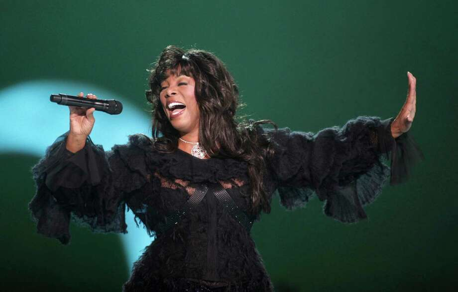 "FILE - This Dec. 11, 2009 file photo shows Donna Summer performing at the Nobel Peace concert in Oslo, Norway. The eclectic group of rockers Rush and Heart, rappers Public Enemy, songwriter Randy Newman, ""Queen of Disco"" Donna Summer and bluesman Albert King will be inducted into the Rock and Roll Hall of Fame next April in Los Angeles. The inductees were announced Tuesday by 2012 inductee Flea of The Red Hot Chili Peppers at a news conference in Los Angeles. (AP Photo/John McConnico, file) Photo: John McConnico"