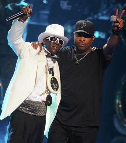 "FILE - This Sept. 23, 2009 file photo shows Rappers Flavor Flav, left, and Chuck D of the music group Public Enemy, perform at the 2009 VH1 Hip Hop Honors at the Brooklyn Academy of Music, in New York. The eclectic group of rockers Rush and Heart, rappers Public Enemy, songwriter Randy Newman, ""Queen of Disco"" Donna Summer and bluesman Albert King will be inducted into the Rock and Roll Hall of Fame next April in Los Angeles. The inductees were announced Tuesday by 2012 inductee Flea of The Red Hot Chili Peppers at a news conference in Los Angeles. (AP Photo/Peter Kramer, file) Photo: Peter Kramer"