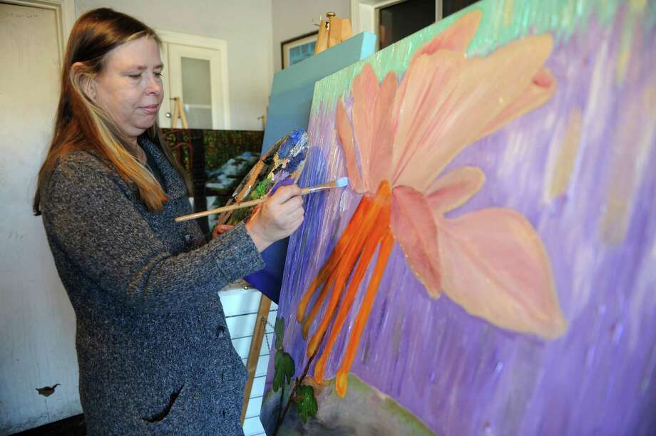 As president of Artists Alive and Well, Suzanne Buckland seeks to help members learn the business side of being an artist. She specializes in oil paintings, above and below right. The group is staging a juried exhibit at 1600 Smith St. Photo: Thomas Nguyen, Freelance / Freelance