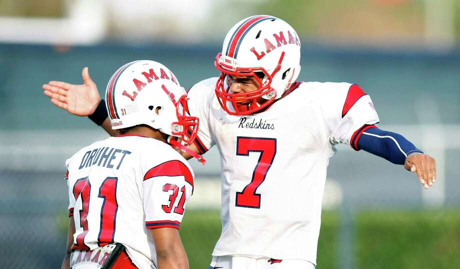Lamar receiver Daijon Druhet, left, celebrates his touchdown catch and run with quarterback Darrel Colbert during the third quarter of the Redskins' 28-7 Class 5A Division I Region III final win against North Shore last week. Photo: Nick De La Torre, Staff / © 2012  Houston Chronicle