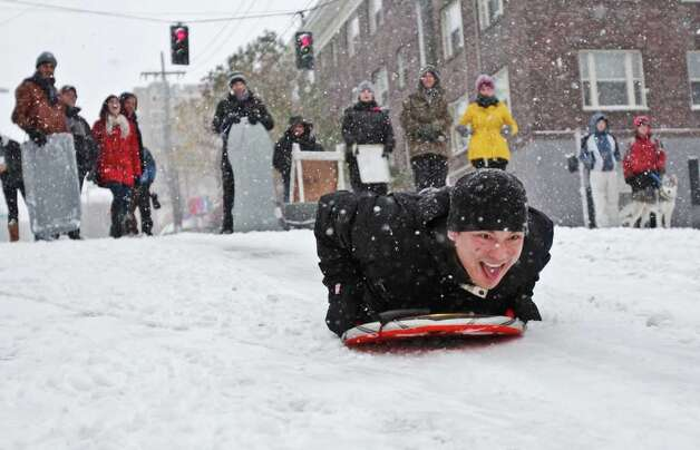 Teddy Basladynski sleds down East Denny Way in Seattle on Wednesday, Jan. 18, 2012. The street is a popular sledding destination when it snows. Photo: JOE DYER / SEATTLEPI.COM