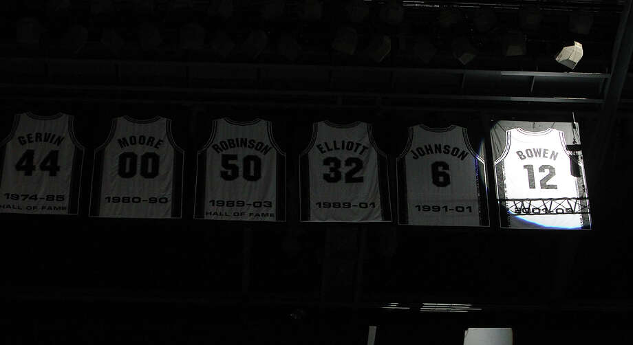 Former Spurs forward Bruce Bowen's jersey hangs in the rafters at the AT&T Center along with those of several other former Spurs standouts. Photo: KIN MAN HUI / ©2012 San Antonio Express-News