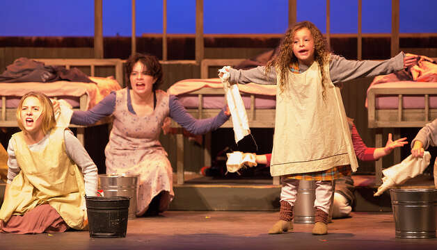 FOR SA LIFE - Olivia Silva, 8, playing Molly, right, performs with Tess Acosta, 16, center, and Ava Schweninger, 13, playing Pepper, during a dress rehearsal of Annie at the San Pedro Playhouse on Monday, Dec. 3, 2012. MICHAEL MILLER / FOR THE EXPRESS-NEWS Photo: Michael Miller, Freelance / © San Antonio Express-News