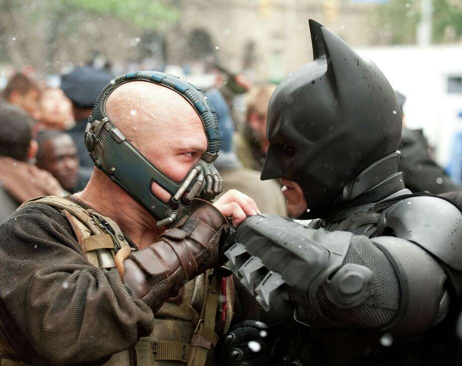 "Bane (Tom Hardy, left) and Batman (Christian Bale) face off in ""The  Dark Knight Rises."" The film has been criticized for its intense  violence. Photo: Warner Bros."