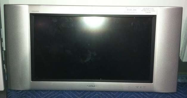 This Sharp 30-inch TV is being auctioned by the U.S. Marshals Office. Photo: Picasa, .