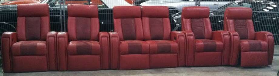 These red theater chairs are being auctioned by the U.S. Marshals Office. Photo: Picasa, .
