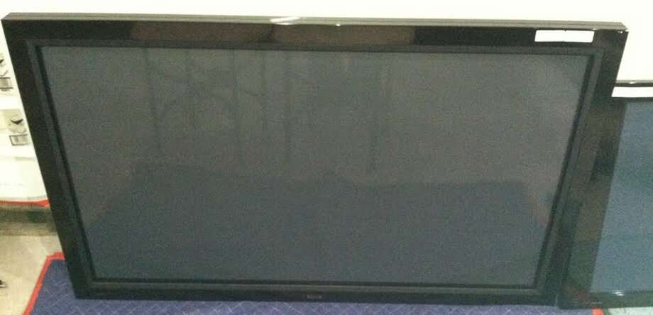 This Pioneer 52-inch TV is being auctioned by the U.S. Marshals Office. Photo: Picasa, .