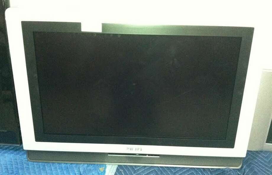 This Phillips 35-inch TV is being auctioned by the U.S. Marshals Office. Photo: Picasa, .