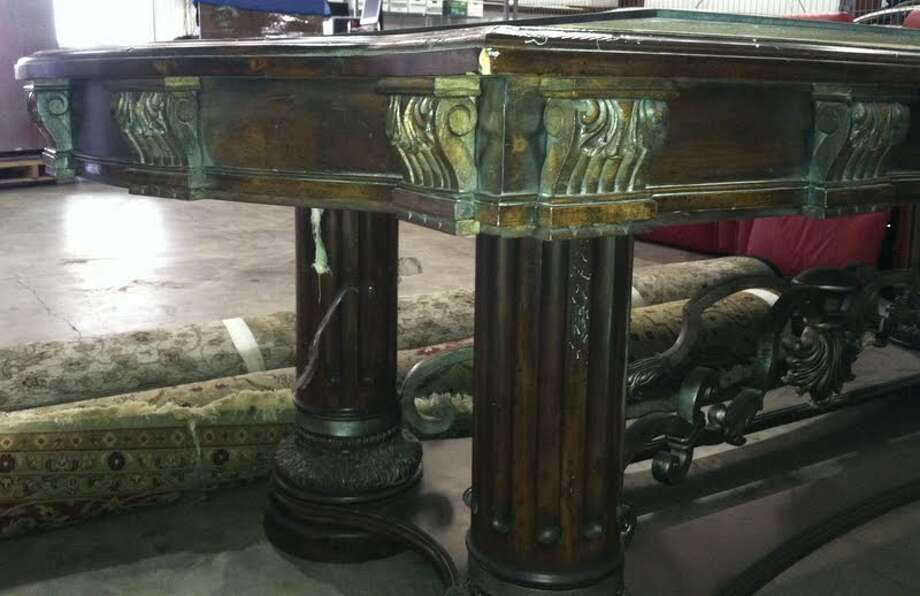 This baroque-style dining table is being auctioned by the U.S. Marshals Office. Photo: Picasa, .