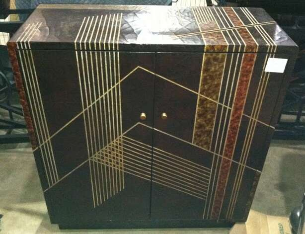 This lacquered, art deco-style cabinet is being auctioned by the U.S. Marshals Office. Photo: Picasa, .