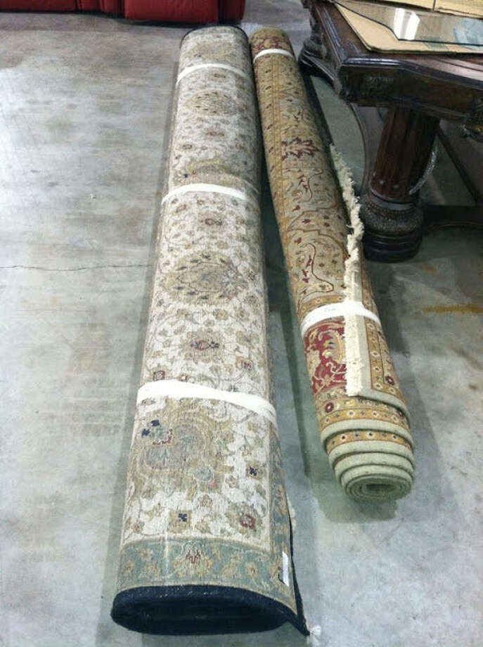 .These Indo-Isfahan rugs are being auctioned by the U.S. Marshals Office. Photo: Picasa, .