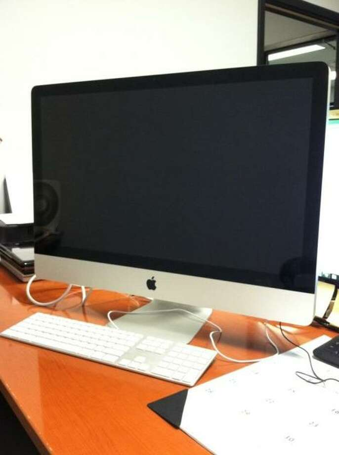 This iMac 27 computer is being auctioned by the U.S. Marshals Office. Photo: Picasa, .