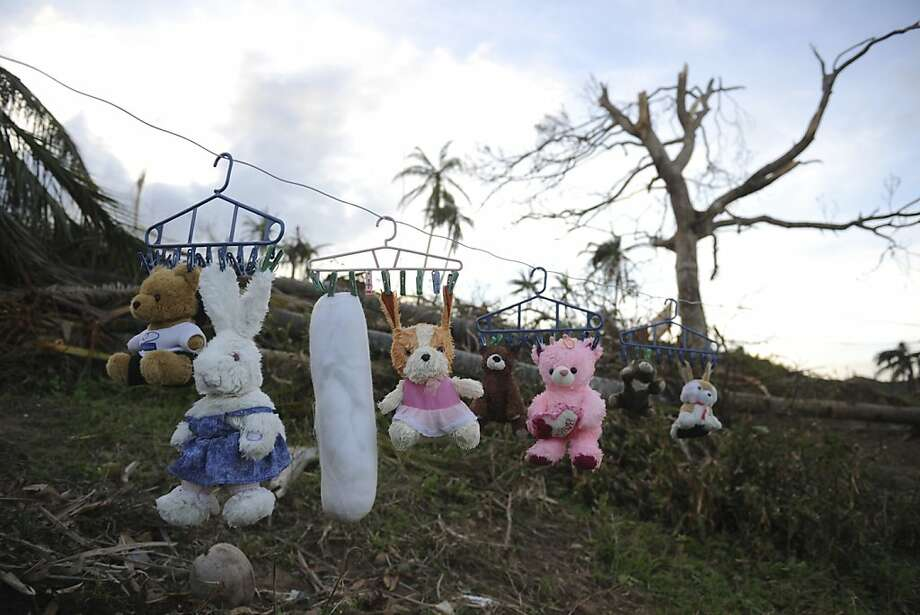 Drying your hare:Stuffed animals soaked by Typhoon Bopha hang on a clothesline in Boston town, Davao Oriental, Philippines. Photo: Ted Aljibe, AFP/Getty Images