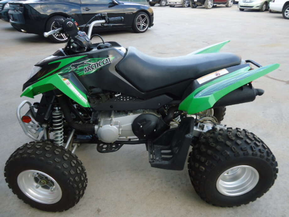 This 2008 Arctic Cat DVX-90 ATV is being auctioned by the U.S. Marshals Office. Photo: Picasa, .