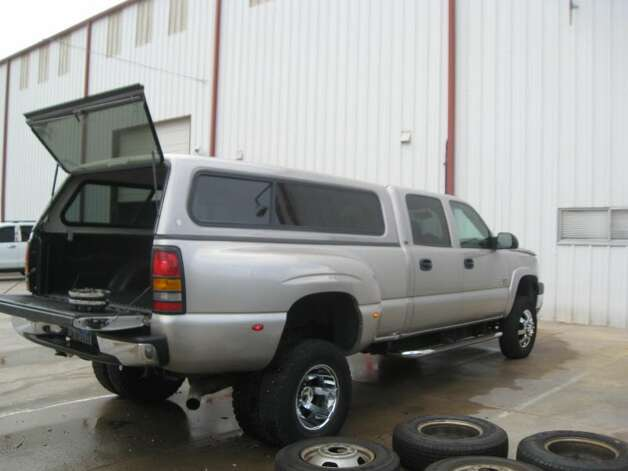 This 2005 Chevy Silverado 3500 is being auctioned by the U.S. Marshals Office. Photo: Picasa, .