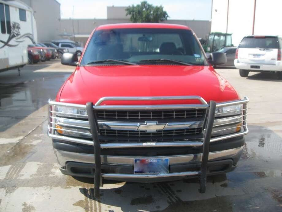 This 2002 Chevy Silverado 1500 is being auctioned by the U.S. Marshals Office. Photo: Picasa, .