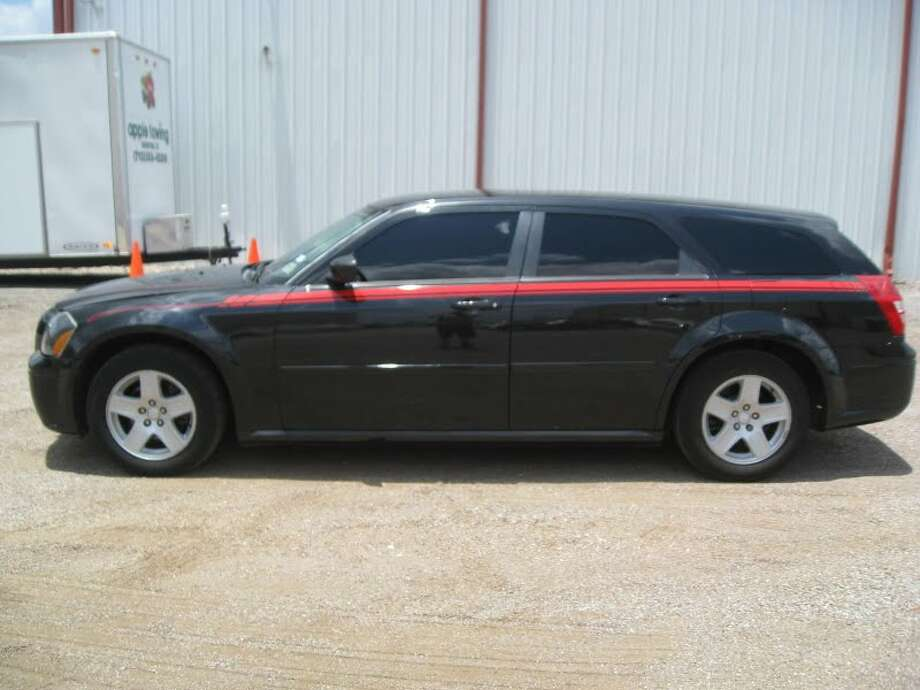 This 2006 Dodge Magnum is being auctioned by the Harris County DA's Office. Photo: Picasa, Apple Towing