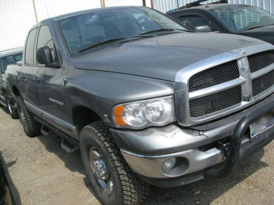 This 2005 Dodge 2500 Quad Cab is being auctioned by the Harris County DA's Office. Photo: Picasa, Apple Towing