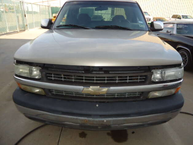 This 2002 Chevy Silverado is being auctioned by the Harris County DA's Office. Photo: Picasa, Apple Towing