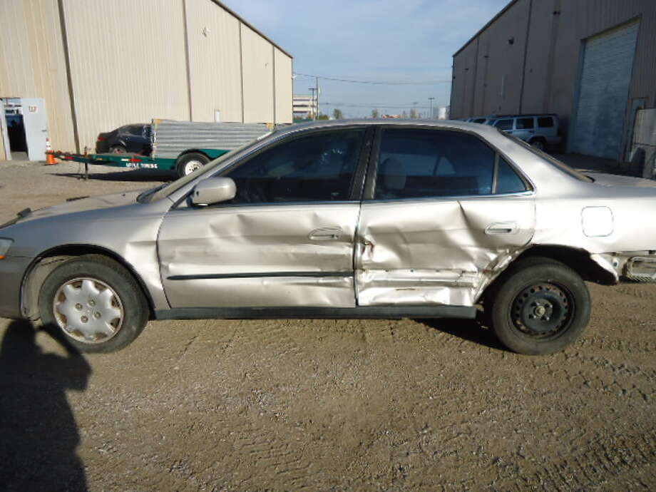 This 1999 Honda Accord is being auctioned by the Harris County DA's Office. Photo: Picasa, Apple Towing