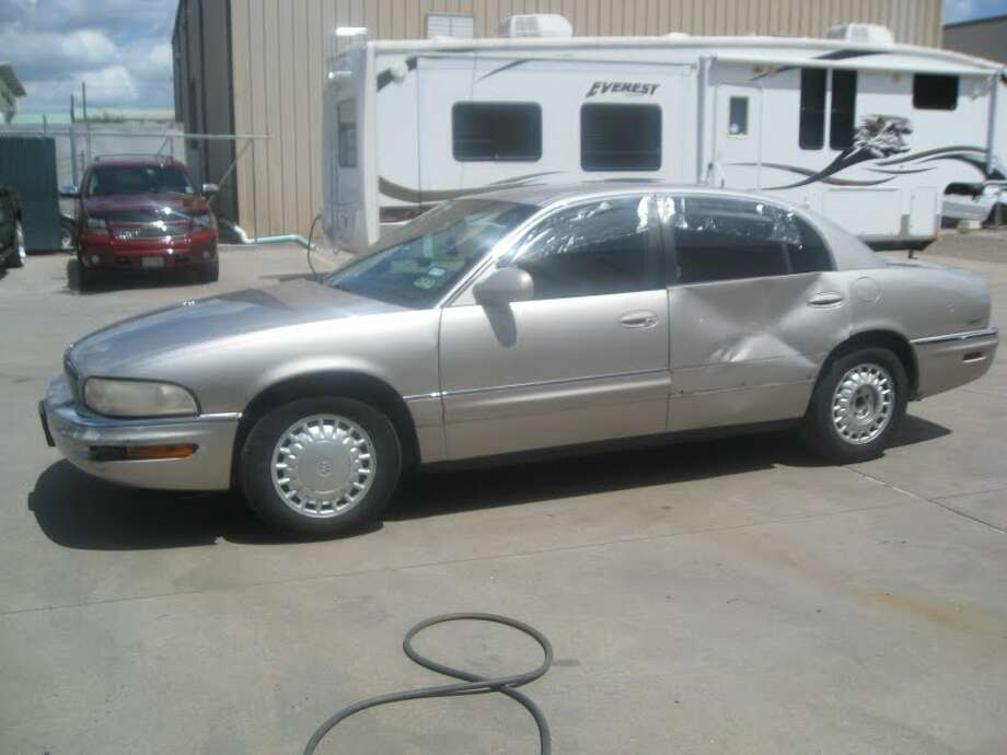 This 1997 Buick Park Avenue is being auctioned by the Harris County DA's Office. Photo: Picasa, Apple Towing