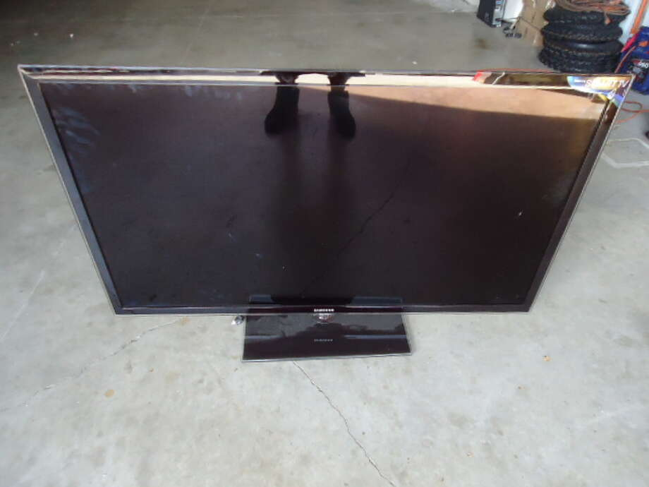 This 55-inch Samsung flat-screen TV is being auctioned by the Harris County DA's Office. Photo: Picasa, Apple Towing