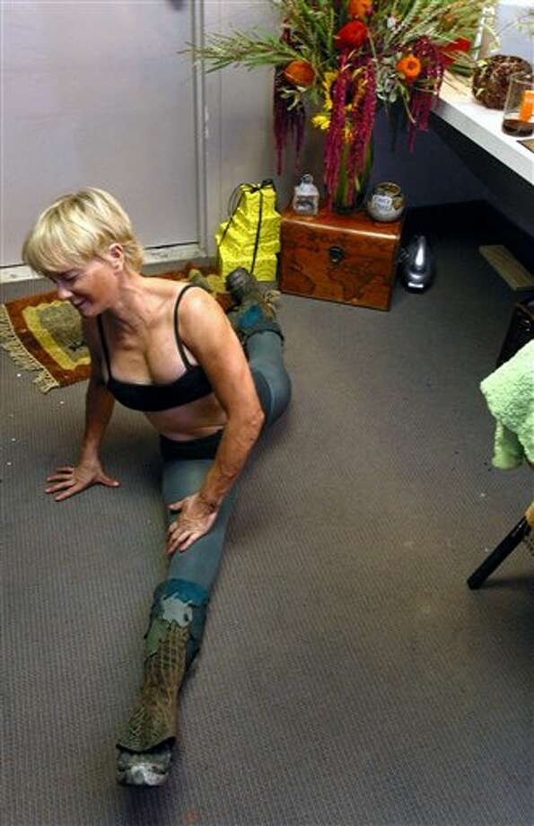 In 2004 she was still pretty flexible.  Photo: STEFANO PALTERA, Ap / AP2004