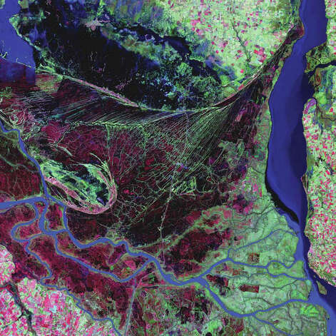 The Paraná River delta is a forested marshland about 32 kilometers northeast of Buenos Aires and has a vast labyrinth of marsh and trees. The delta is home to a number of rare birds and has become a popular bird-watching destination. It is also home to marsh deer, jaguars, neotropical river otters, coypu and capybara rodents, and the Pampas cat. The Paraná flows north-south and forms an alluvial basin before it empties into the Río de la Plata. This Landsat 7 image from 2000 highlights the striking contrast between dense forest, wetland marshes, and the deep blue ribbon of the Paraná River. Photo: NASA