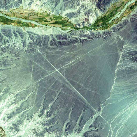 The Nazca Lines are a series of ancient geoglyphs located in the Ica Region in southern Peru. Estimated to be created by the Nazca culture between 400 and 650 C.E., the Nazca Lines were made by removing reddish iron-oxide pebbles that cover the surface of the desert. When the gravel is removed, the lines contrast with the light color underneath. In this 2000 Terra image, the straight Nazca Lines differ sharply from the natural, wavy lines formed from water flow in the area. Overall, there are hundreds of individual figures, which range in complexity from simple lines to stylized hummingbirds, spiders, monkeys, fish, sharks, orcas, llamas, and lizards. The Nazca Lines were designated a UNESCO World Heritage Site in 1994. Photo: NASA