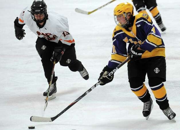 Westhill's Frank Compolattaro controls the puck as Stamford and Westhill High Schools compete in a Boys Ice Hockey Jamboree at Terry Conners Ice Rink in Stamford on Saturday, December 8, 2012. Photo: Lindsay Niegelberg / Stamford Advocate