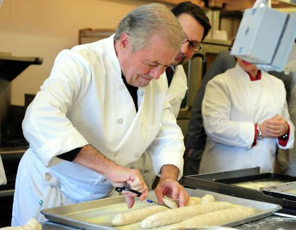 Chef Jacques Pépin and culinary students at Emmett OíBrien Technical High School cook more than 90 meals  Tuesday, Dec. 11, 2012 for the Spooner House, a Shelton nonprofit that provides emergency shelter, meals, and services to families in the Naugatuck Valley. Photo: Autumn Driscoll / Connecticut Post