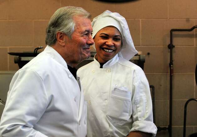 Chef Jacques Pépin chats with culinary student Joel Martinez during a visit to Emmett OíBrien Technical High School Tuesday, Dec. 11, 2012.  Pépin and students cooked more than 90 meals together for the Spooner House, a Shelton nonprofit that provides emergency shelter, meals, and services to families in the Naugatuck Valley. Photo: Autumn Driscoll / Connecticut Post