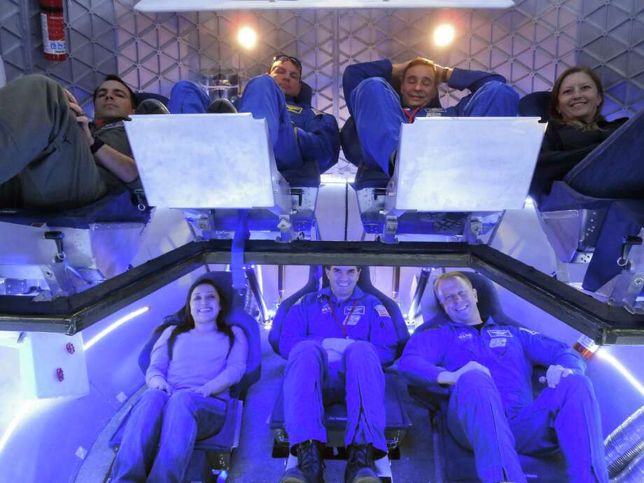 NASA astronauts and SpaceX team members sit inside the Dragon Crew Capsule Engineering Model in April 2012. Photo: SpaceX