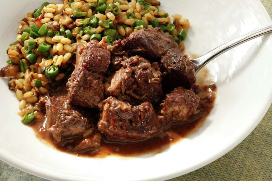 Braised Pork with Barley is a great cool-weather dish. Food styled by Katie Fleming. Photo: Craig Lee, Special To The Chronicle / ONLINE_YES
