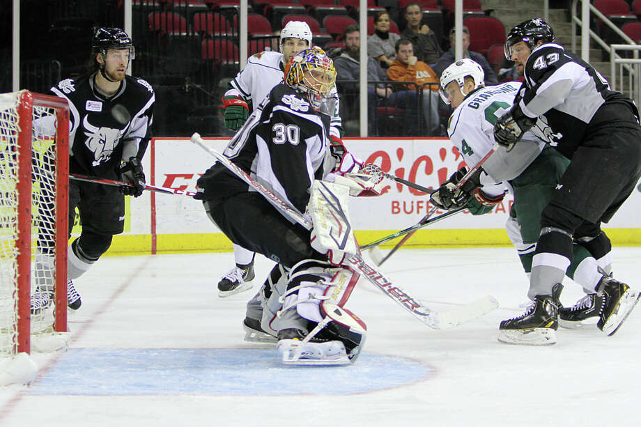 Aeros center Mikael Granlund, right, looks to slip a shot past Rampage goalie Jacob Markstrom (30) during Tuesday's win at Toyota Center. (Morris Molina/Houston Aeros)