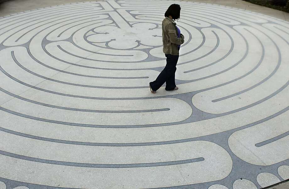 René Fay regularly walks the labyrinth outside Grace Cathedral to relax and meditate. She is seen here on Monday, December 10, 2012, on San Francisco, Calif., walking the path. Photo: Carlos Avila Gonzalez, The Chronicle