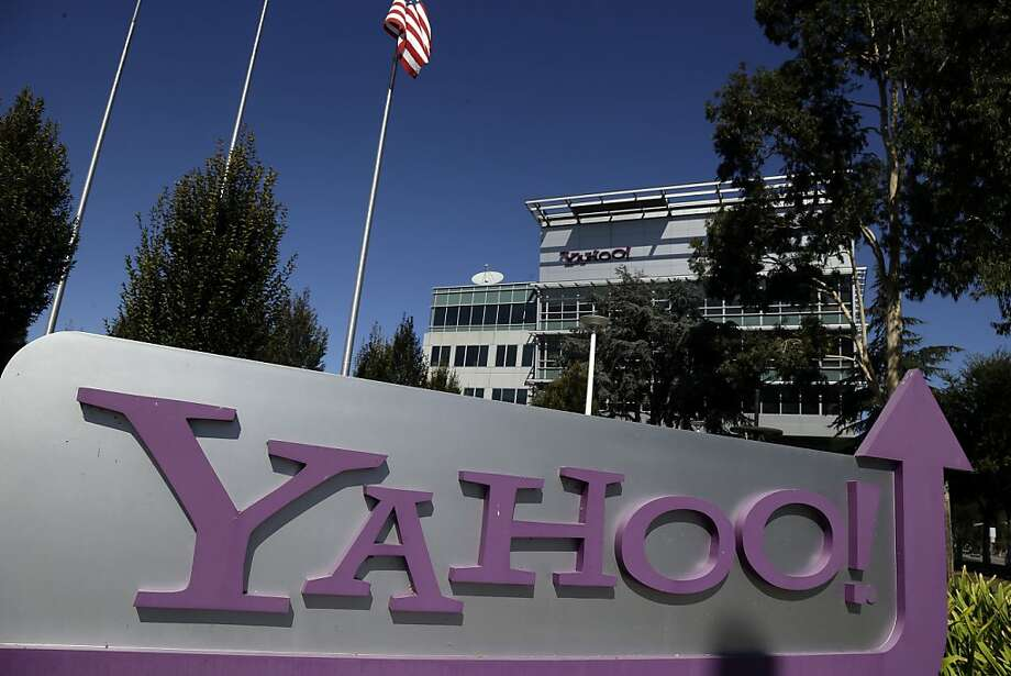 This Wednesday, Oct. 17, 2012, photo, shows a sign in front of Yahoo! headquarters in Sunnyvale, Calif., Wednesday, Oct.  17, 2012. Yahoo has ushered in Marissa Mayer as its new CEO with a third-quarter earnings report that topped analyst estimates. The results announced Monday Oct. 22, 2012, show Yahoo's net revenue barely grew at a time when advertisers are spending more money marketing their products and services online. Nevertheless, the numbers were slightly better than analysts projected. (AP Photo/Marcio Jose Sanchez) Photo: Marcio Jose Sanchez, Associated Press
