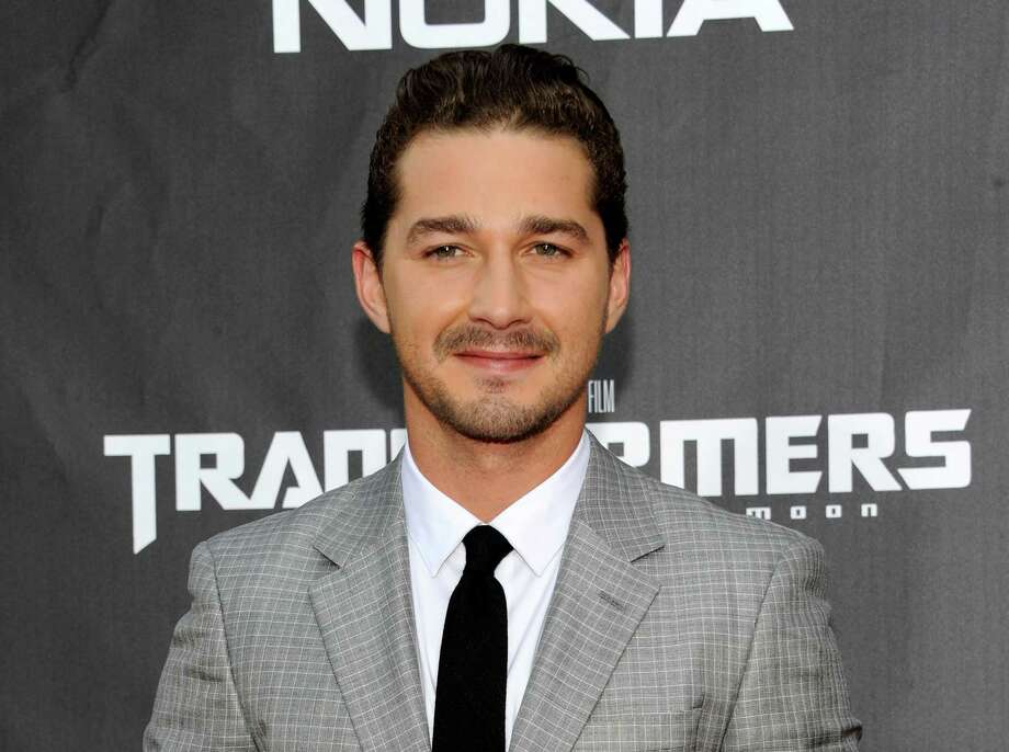"FILE - This June 28, 2011 file photo shows actor Shia LaBeouf attending the ""Transformers: Dark of the Moon"" premiere in Times Square in New York. LaBeouf will join fellow actor Alec Baldwin as he makes his Broadway debut in ""Orphans."" The play will begin performances on March 19 and open on April 7, 2013 at the Schoenfeld Theatre in New York. (AP Photo/Evan Agostini, file) Photo: Evan Agostini"