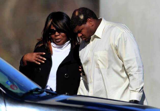 CORRECTS BYLINE TO LM OTERO, NOT TONY GUTIERREZ - Dallas Cowboys football player Josh Brent, right, arrives embracing an unidentified person at a memorial service for teammate Jerry Brown at Oak Cliff Bible Fellowship education center, Tuesday, Dec. 11, 2012, in Dallas. Brown died in a suspected drunken-driving accident on Saturday. Brent was the driver and is charged with intoxication manslaughter. (AP Photo/LM Otero) Photo: LM Otero, Associated Press / AP