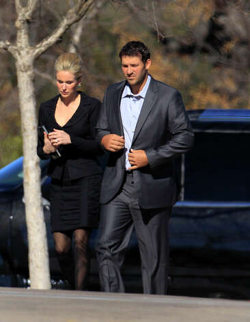 Dallas Cowboys quarterback Tony Romo, right, and his wife Candice, center, arrive a a memorial service for practice squad member Jerry Brown at Oak Cliff Bible Fellowship Tuesday, Dec. 11, 2012, in Dallas. (AP Photo/LM Otero) Photo: LM Otero, Associated Press / AP