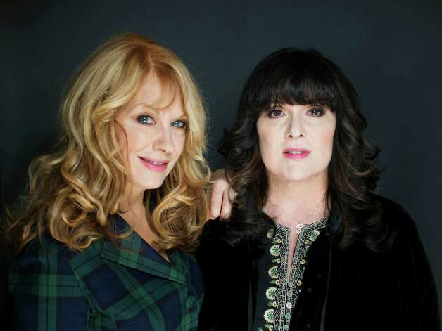 "CORRECTS LEFT TO RIGHT  INDENTIFICATIONS--FILE - This Oct. 1, 2012 file photo shows sisters Nancy, left, and Ann Wilson from Heart in New York. The eclectic group of rockers Rush and Heart, rappers Public Enemy, songwriter Randy Newman, ""Queen of Disco"" Donna Summer and bluesman Albert King will be inducted into the Rock and Roll Hall of Fame next April in Los Angeles. The inductees were announced Tuesday by 2012 inductee Flea of The Red Hot Chili Peppers at a news conference in Los Angeles. (Photo by Victoria Will/Invision/AP Images) Photo: Victoria Will"