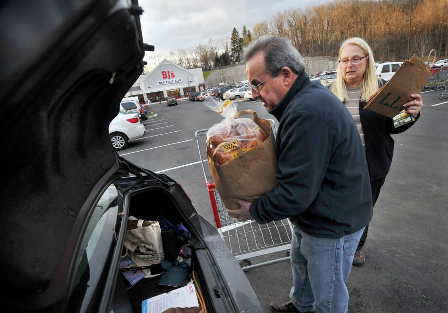Len Boscia and his wife, Michelle, of Bedford, N.Y., load up their car with items purchased at newly opened BJ's Wholesale Club in Brookfield on Tuesday, Dec. 11, 2012. BJ's will be having its grand opening on Saturday, Dec. 15. Photo: Jason Rearick / The News-Times
