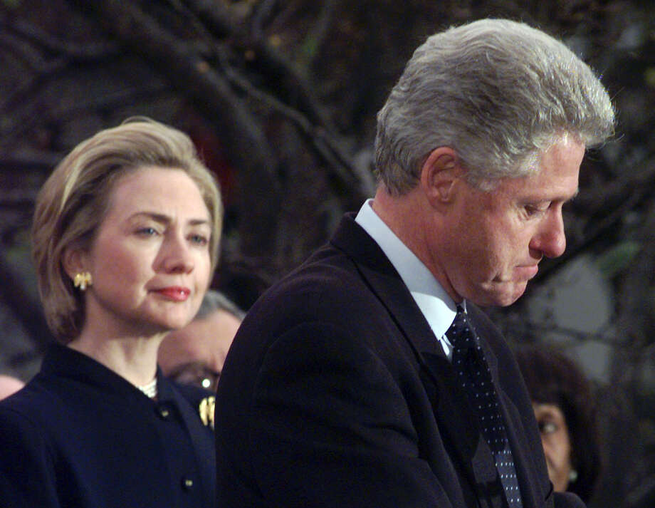 First lady Hillary Clinton watches President Clinton pause as he thanks those Democratic members of the House of Representatives who voted against impeachment in this Dec. 19, 1998 photo. As Hillary is touted as a 2016 presidential hopeful, media such as the New York Times seem to have forgotten this bit of political baggage. Photo: SUSAN WALSH, AP / AP